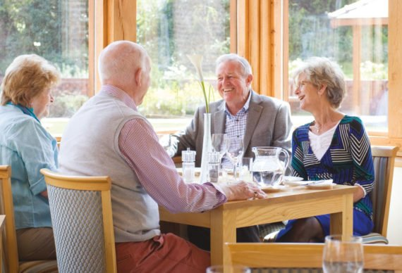 Over 55s socialising at the Boughton Hall restaurant in Chester