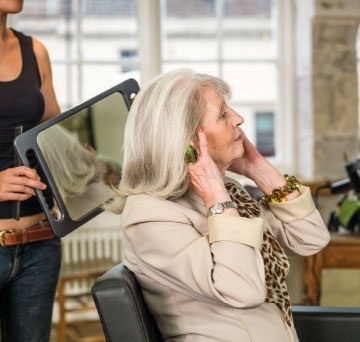 Lady visiting the hairdresser at Boughton Hall