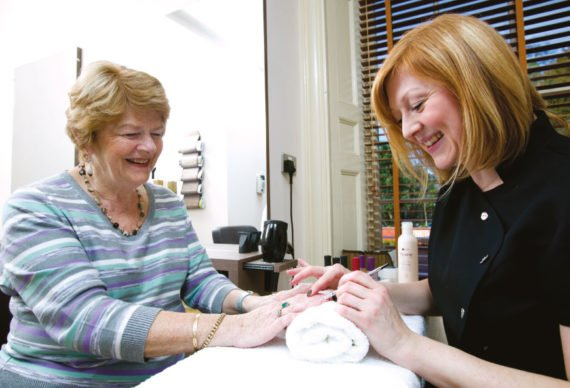 Lady enjoying a manicure at the healthy living wellbeing centre in Boughton Hall